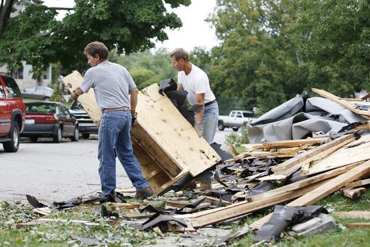 Neighbors helping neighbors was a common scene following the Hurricane Ike related windstorm that devastated parts of Northern Kentucky and the Cincinnati area in September 2008.