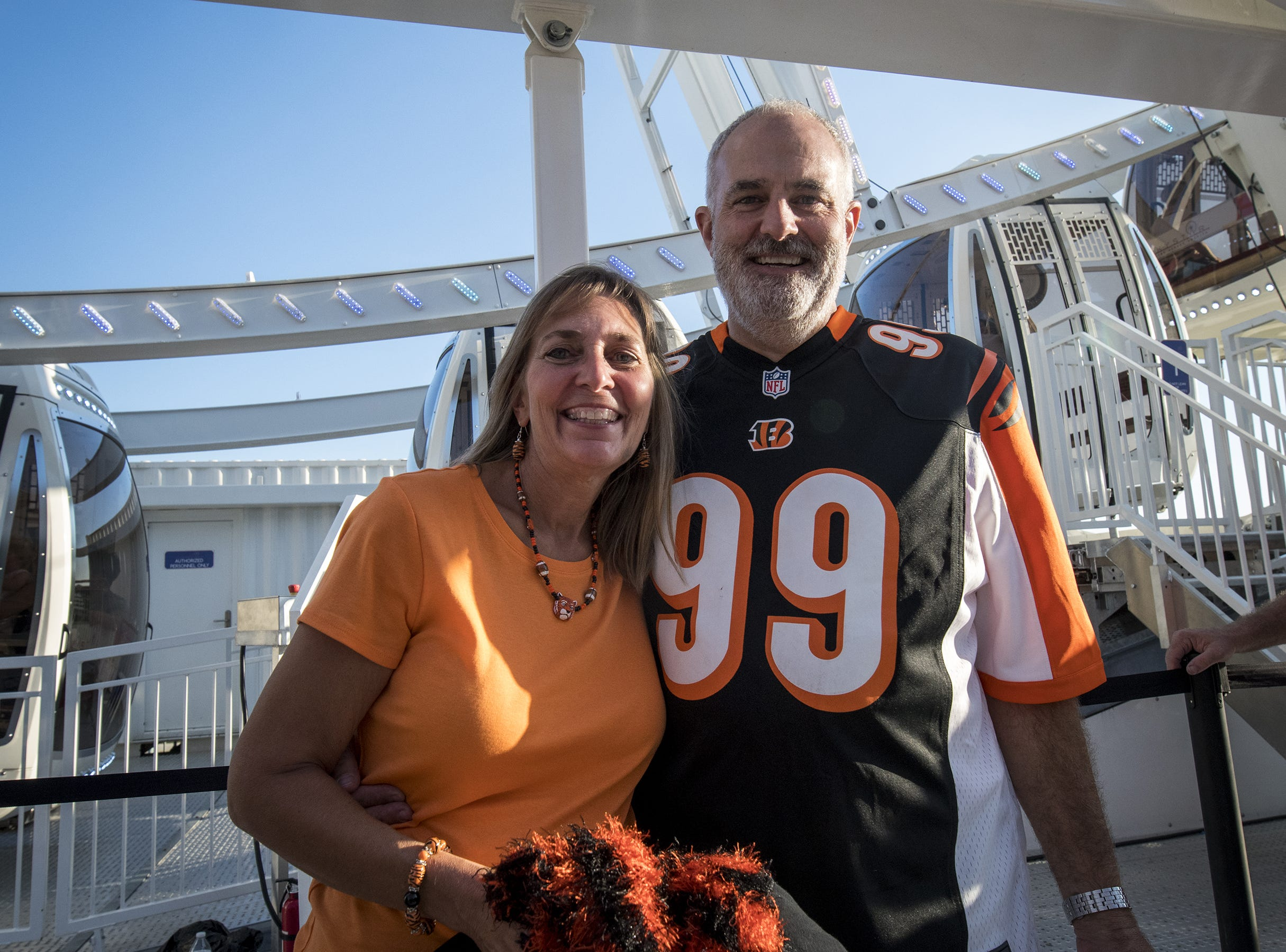 Bengals fans Jocelyn and Rob Marshall of Lebanon take a ride on the sky wheel before the Bengals game against the Baltimore Ravens Thursday, September 13, 2018 in Cincinnati, Ohio.