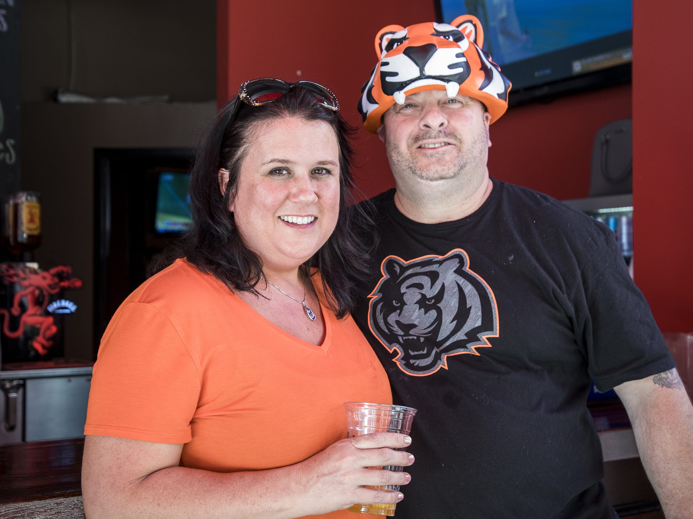 Michelle and Ken Deland of Buffalo New York grab a drink in the Bud Light Tailgate zone before the Bengals game against the Baltimore Ravens Thursday, September 13, 2018 in Cincinnati, Ohio.