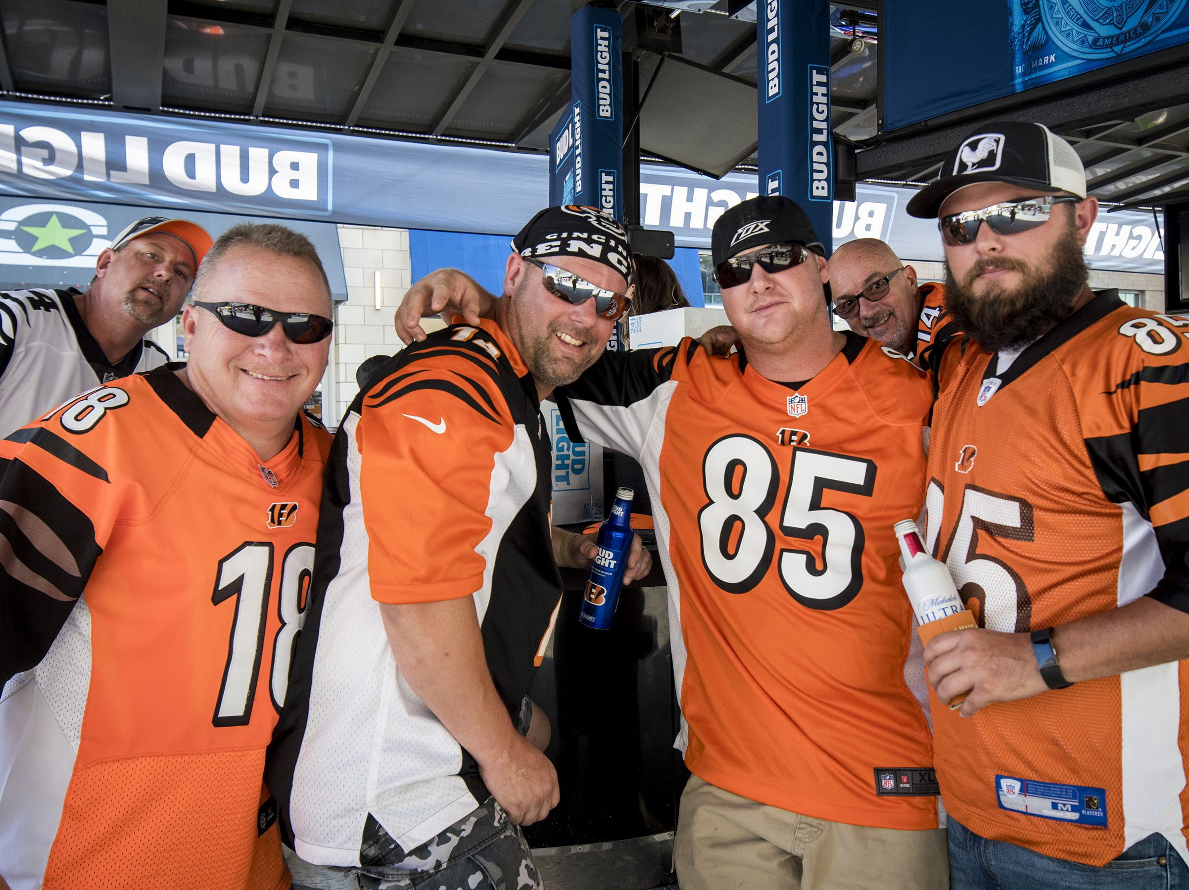 Bengals fans Will Horn, Chris Hack, Dennis Meade and Josh Napier hang out at the Bud Light Tailgate zone before the Bengals game against the Baltimore Ravens Thursday, September 13, 2018 in Cincinnati, Ohio.