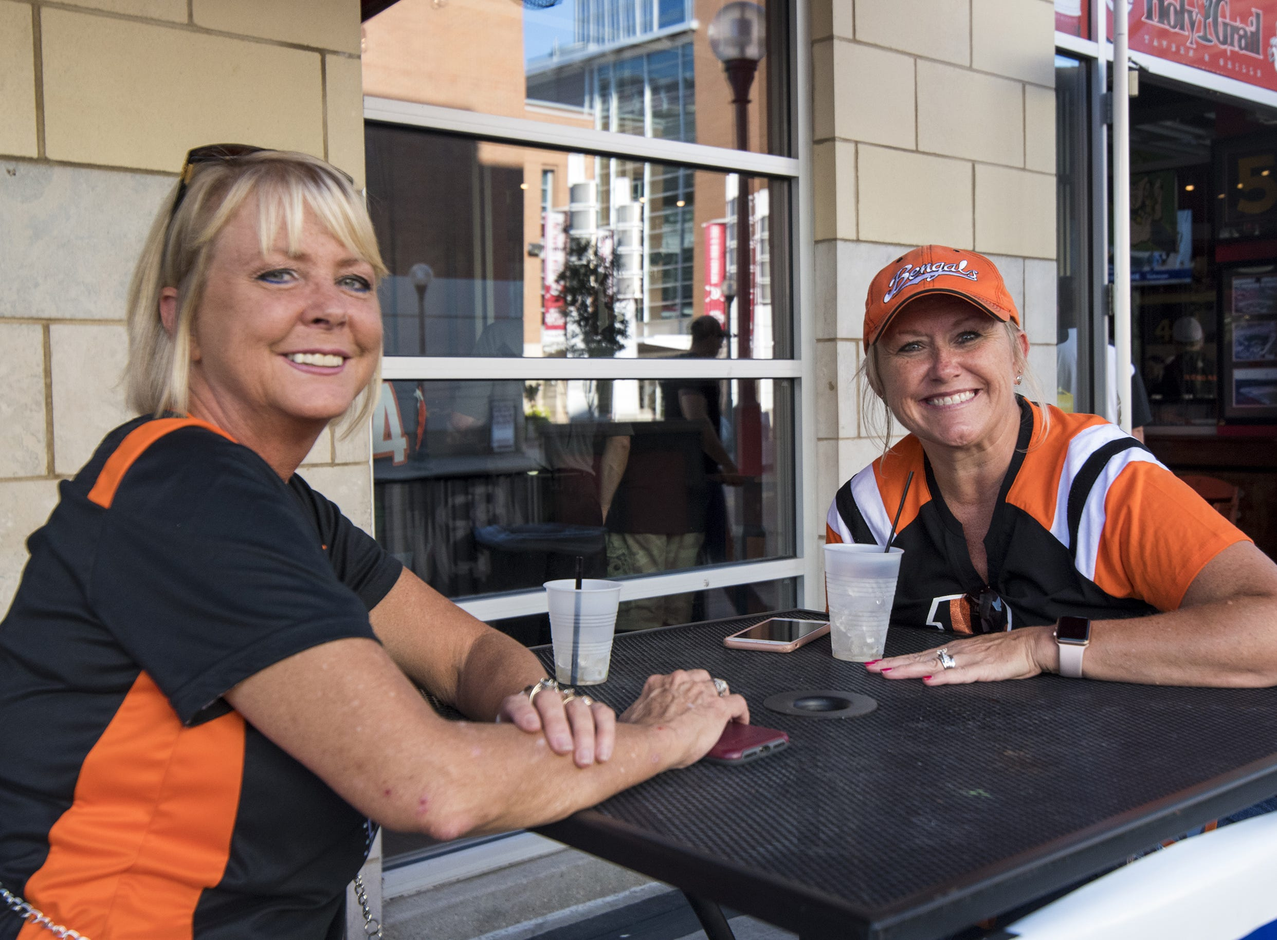 Debbie Cox of Burlington and Paige Olson of Loveland grab drink at the Holy Grail before the Bengals game against the Baltimore Ravens Thursday, September 13, 2018 in Cincinnati, Ohio.