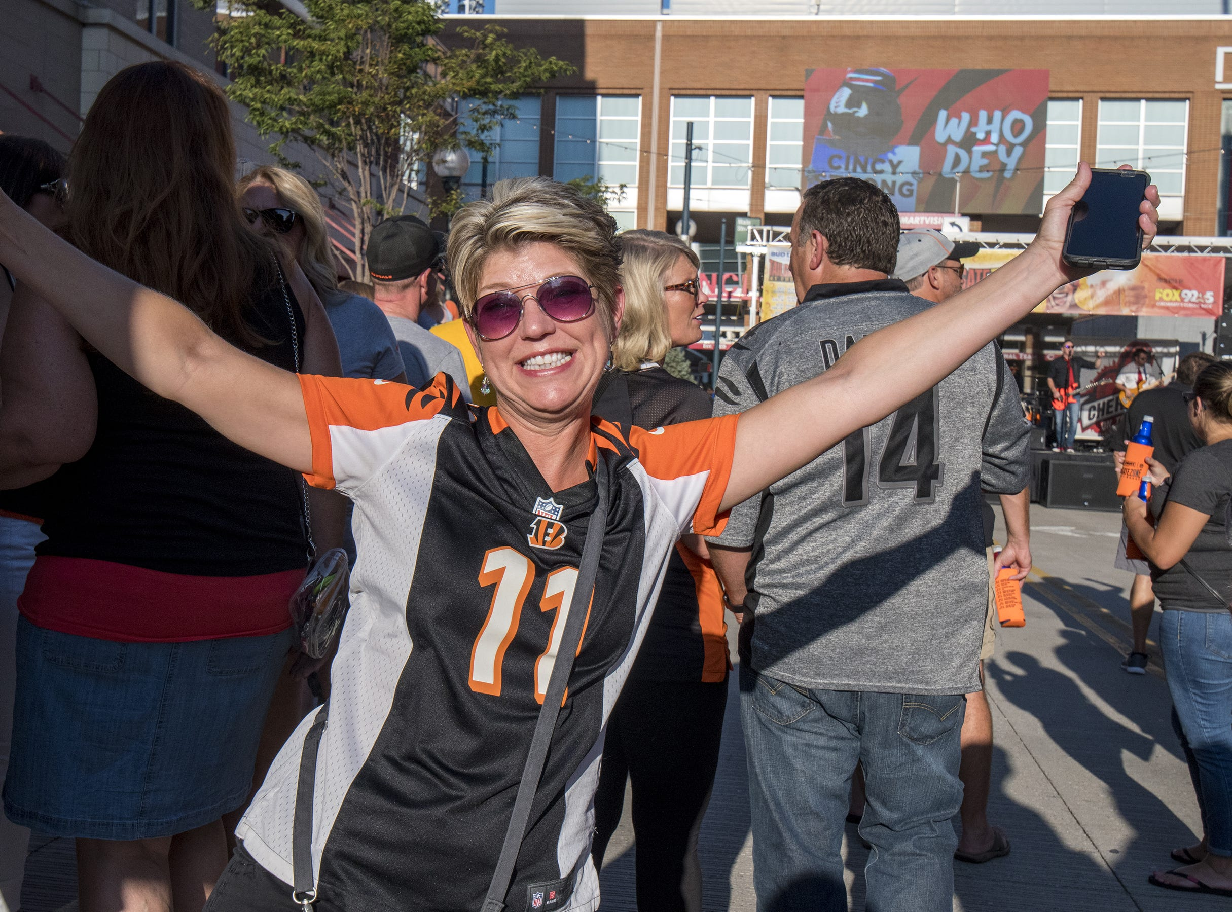 Sheryl Messier of Westwood grabs a drink in the Bud Light Tailgate zone before the Bengals game against the Baltimore Ravens Thursday, September 13, 2018 in Cincinnati, Ohio.