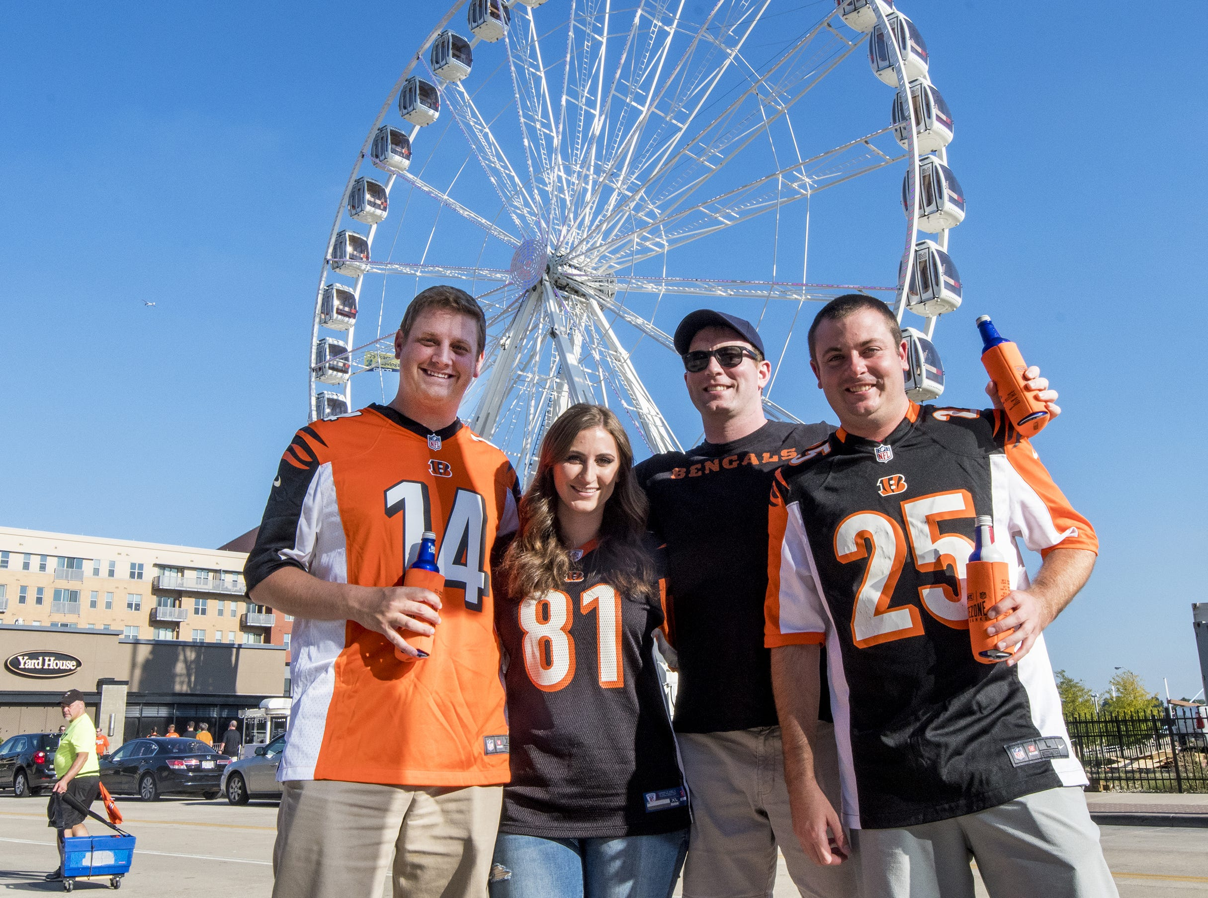 Bengals fans Mitchell Smith, Bryanna Owens, Joe Gillespie and Sean O'Daniel hang out in the Bud Light tailgate zone before the Bengals game against the Baltimore Ravens Thursday, September 13, 2018 in Cincinnati, Ohio.