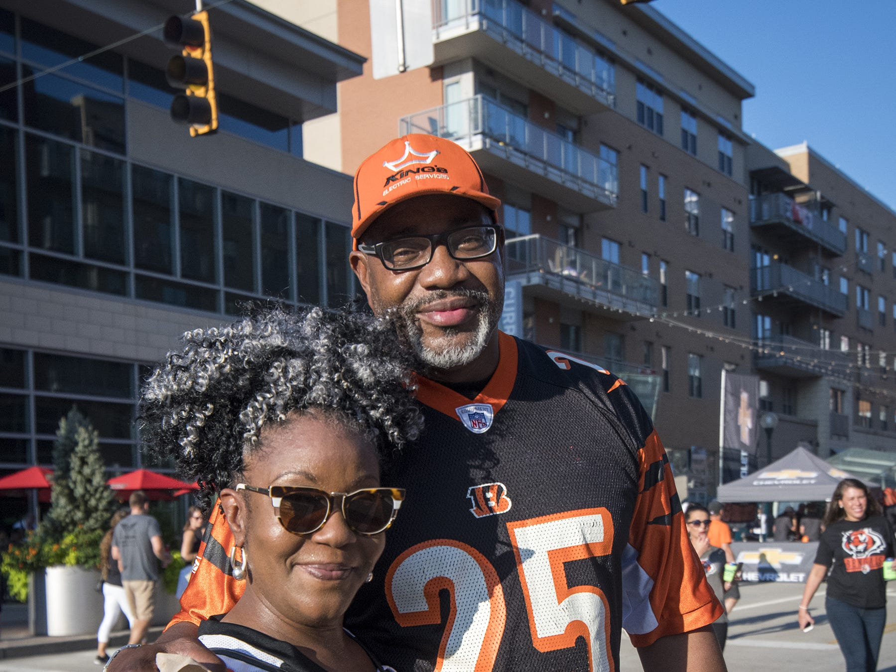 Angie Fairbanks and Fred Williams grab a drink at the Bud Light Tailgate zone before the Bengals game against the Baltimore Ravens Thursday, September 13, 2018 in Cincinnati, Ohio.