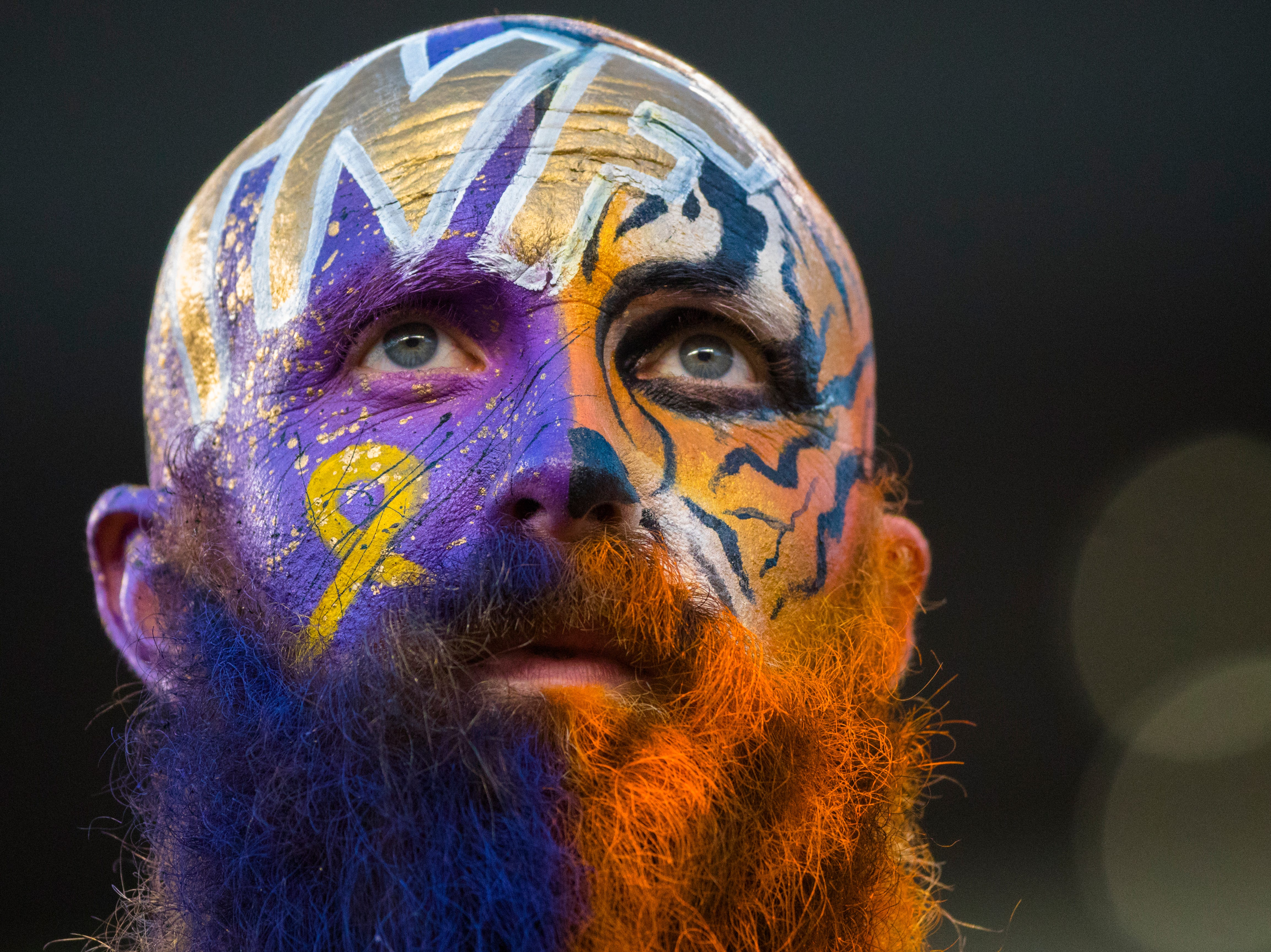 Garey Faulkner looks on before the Week 2 NFL game between the Cincinnati Bengals and the Baltimore Ravens, Thursday, Sept. 13, 2018, at Paul Brown Stadium in Cincinnati. Gary said he painted his face half for the Ravens and half for the Bengals because over the years of attending NFL games he's met so many great people from every city.