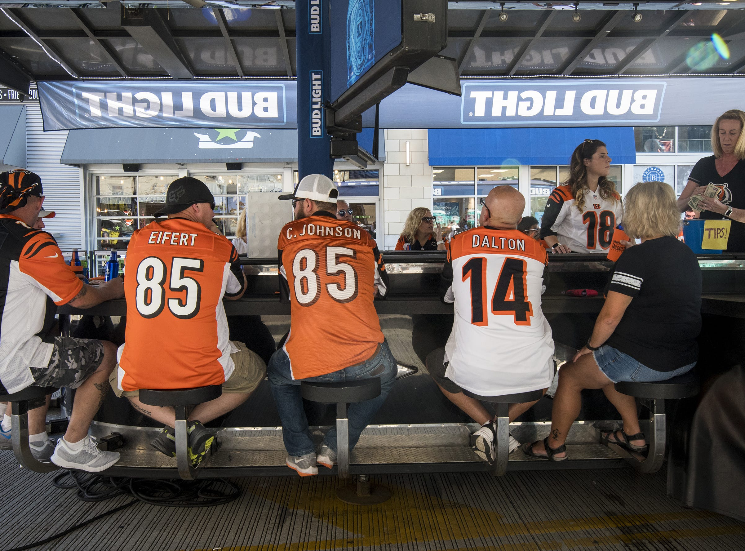 Bengals fans hang out in the Bud Light Tailgate zone before the Bengals game against the Baltimore Ravens Thursday, September 13, 2018 in Cincinnati, Ohio.