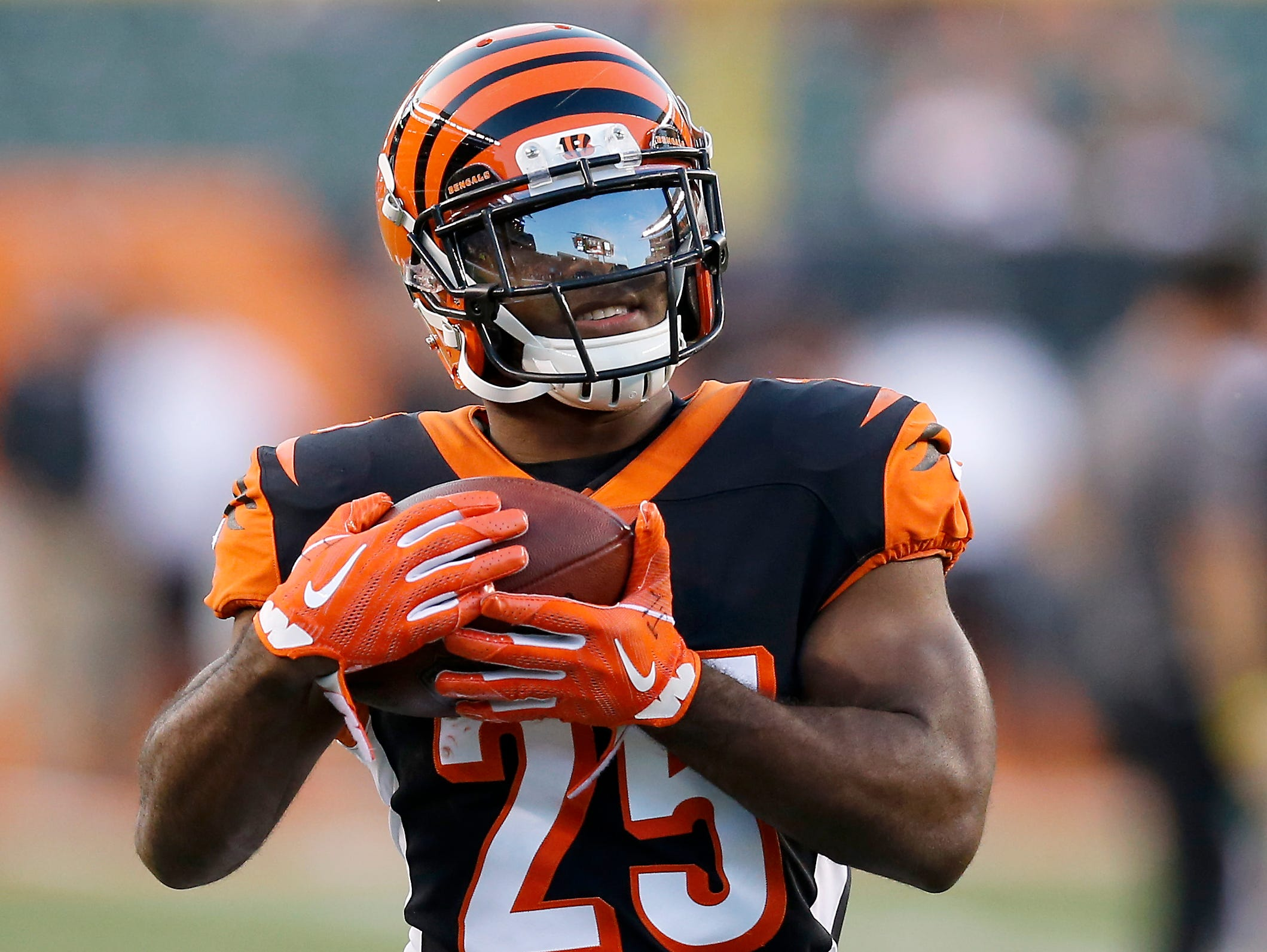 Cincinnati Bengals running back Giovani Bernard (25) catches a pass during pregame warmup before the NFL Week 2 game between the Cincinnati Bengals and the Baltimore Ravens at Paul Brown Stadium in downtown Cincinnati on Thursday, Sept. 13, 2018.