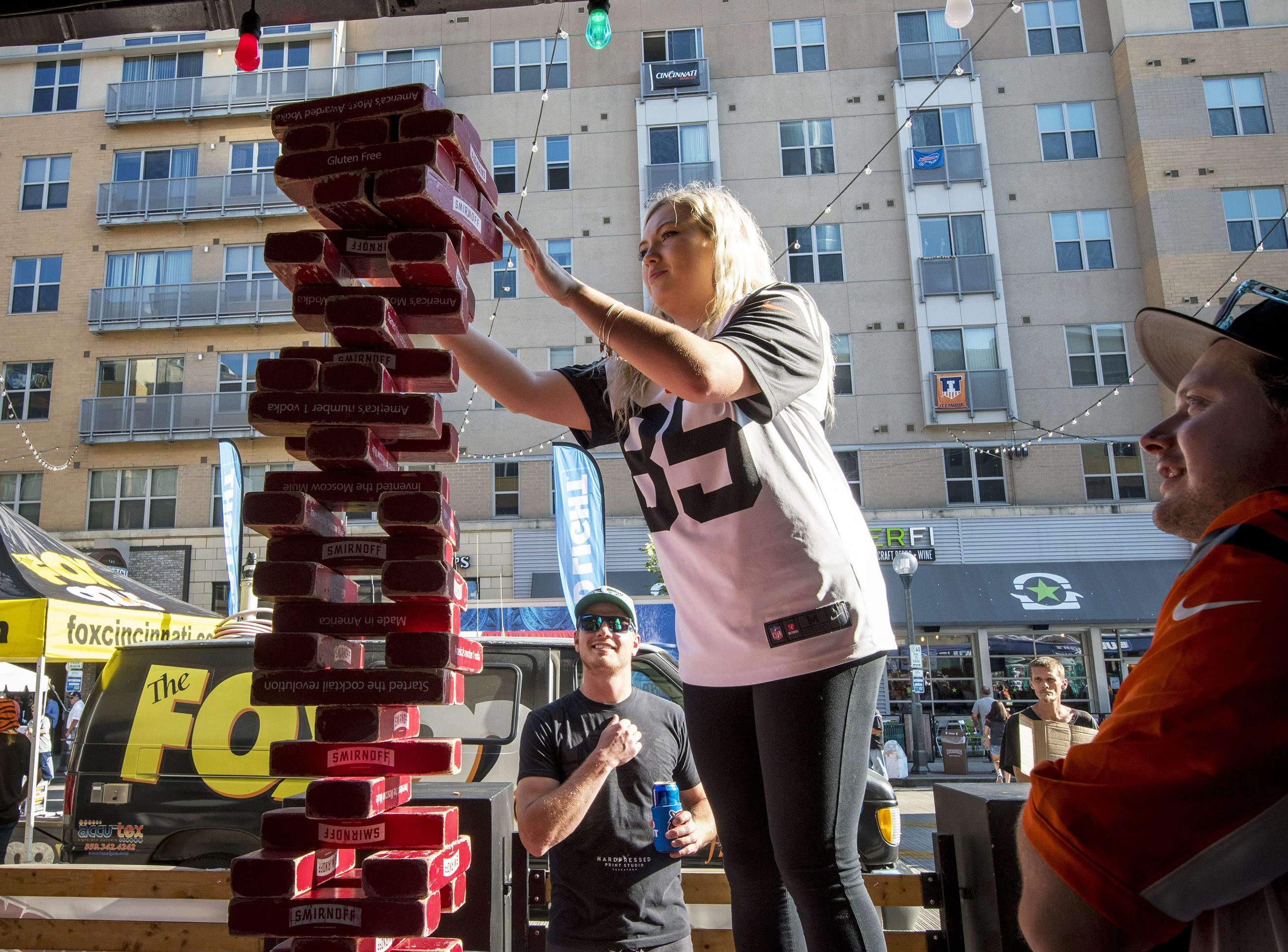 Bengals fan, Tricia Murphy, plays giant jenga at the Tin Roof before the Bengals game against the Baltimore Ravens Thursday, September 13, 2018 in Cincinnati, Ohio.