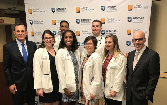 Brian Gragnolati, president and CEO, Atlantic Health System (left) and Stephen K. Klasko, MD, MBA, president, Thomas Jefferson University and CEO, Jefferson Health (right), stand with the first Longitudinal Integrated Clerkship (LIC) students of the Sidney Kimmel Medical College Regional Campus at Atlantic Health System.