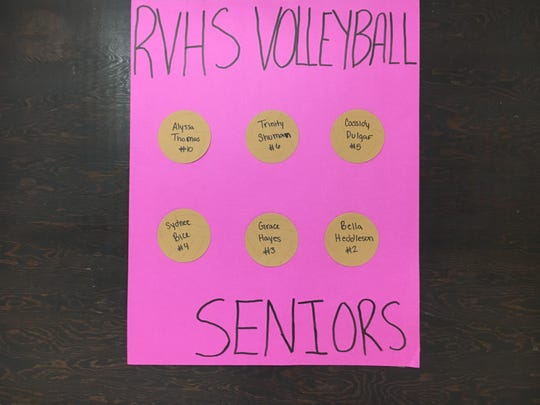 A sign hanging in the River View High School office all of the senior volleyball players.