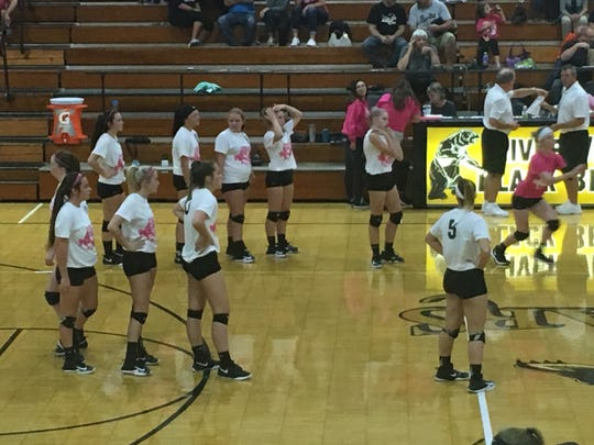 The River View varsity squad warms up before itsVolley for a Cure Match against Coshocton earlier this month.
