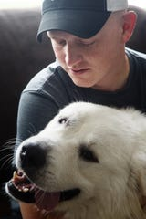 Brice Udelhoven, 26, plays with his dog Mack before leaving for his bi-weekly trip to University of Iowa Hospitals from his home in Mingo on Thursday, Sept. 13, 2018. Earlier this year Brice was diagnosed with rhabdomyosarcoma. According to his doctors at the hospital, this is the first time they have seen the cancer in an adult.