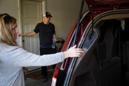 Brice Udelhoven, 26, and his wife Margot get in their van to make their bi-weekly trip to UI Hospitals from their home in Mingo on Thursday, Sept. 13, 2018.