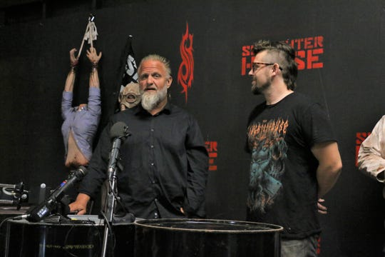 M. Shawn Crahan (left), co-founding Slipknot member, and Ian Miller, Slaughterhouse owner, discuss a Slipknot-themed haunted house opening Oct. 5 in Des Moines.