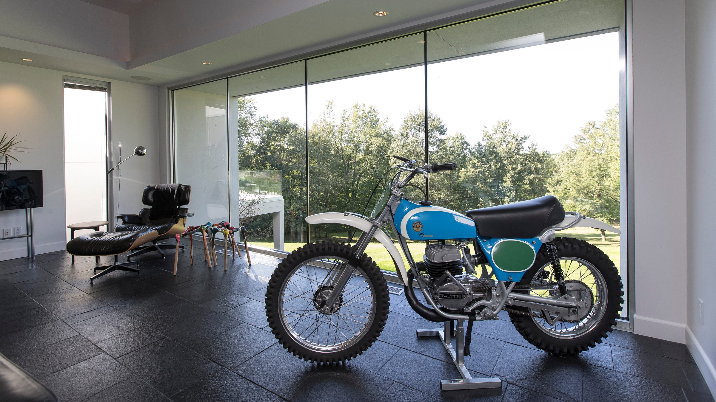 This vintage Bultaco Pursang 250cc is one of three motocross bikes used as objets d'art. This one's in the living room; another is in the front hall and another in the dining-room-turned-pool-room.