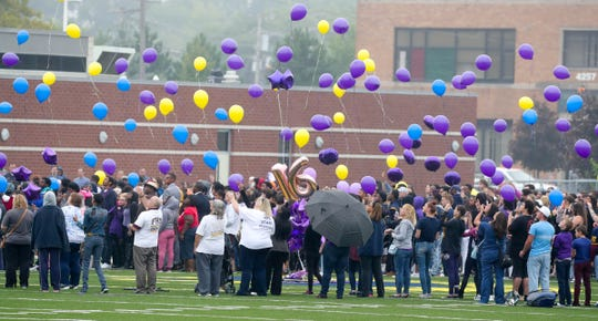 Students and community members released balloons at Fitzgerald High School in Warren to pay tribute to Danyna Gibson, 16, on Thursday, September 13, 2018, in Warren, Mich.