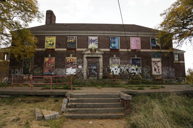 In October 2013, painted signs covered the areas where windows were in the famous Kronk Rec Center in Detroit's west side. Vandals and fire have destroyed much of the building that has been closed for years.