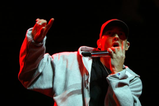 Eminem performs onstage with Kuniva of D12 for the release party of his new album Relapse at the Sound Board stage in the Motor City Casino in Detroit, on Tuesday, May 19, 2009.