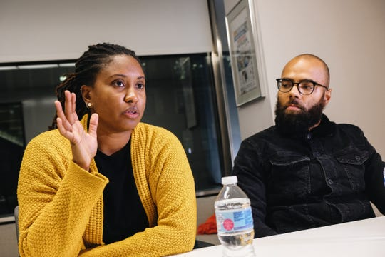 Former Detroit Lions player DeAndre Levy and his wife, Desire Vincent Levy, at the Detroit Free Press office in downtown Detroit on Tuesday December 19, 2017.