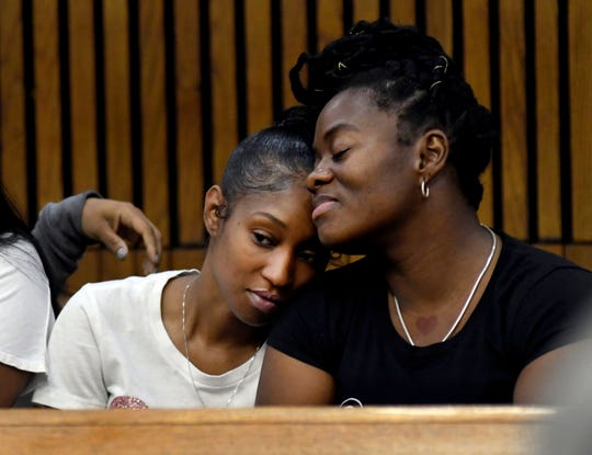 Laurice Henderson, left, the mother of  shooting victim London Muldrow, is comforted by Patrice Kelly, London's grandmother, as they await the sentencing of Exel Taylor Thursday  in Detroit.