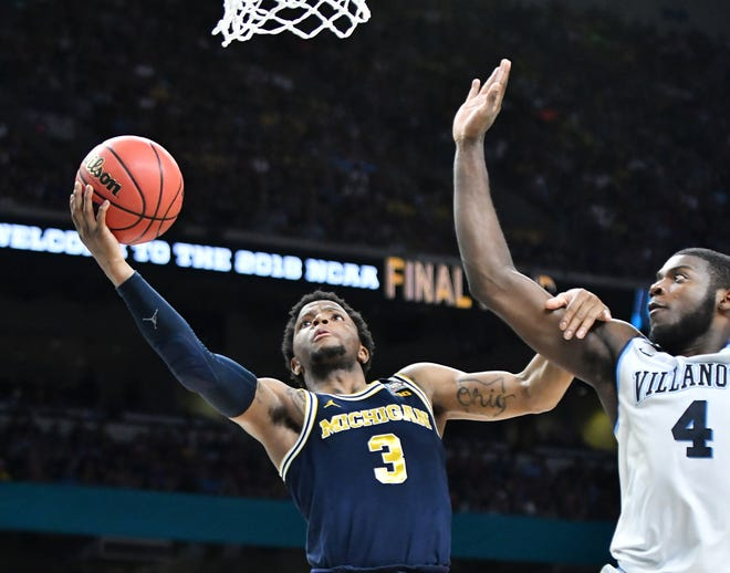 Zavier Simpson (3) and Michigan will take on Eric Paschall (4) and Villanova on the Wildcats' home floor Nov. 14 in the Gavitt Games. Tip-off is 6:30 p.m., and will be broadcast on FS1.