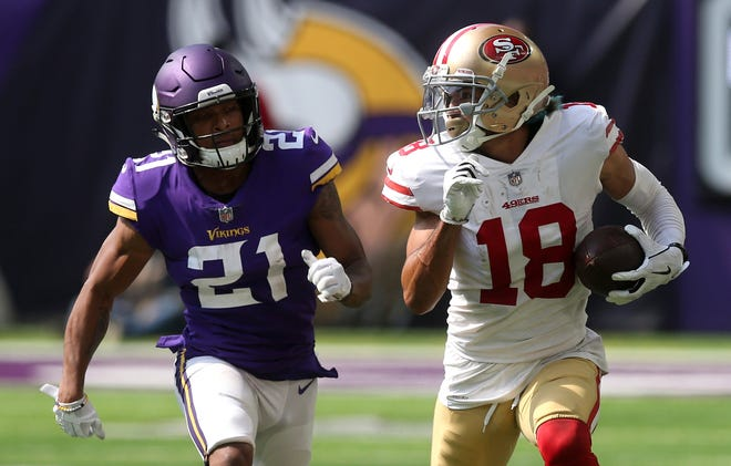 San Francisco 49ers wide receiver Dante Pettis, right, runs from Minnesota Vikings cornerback Mike Hughes after making a reception last week.