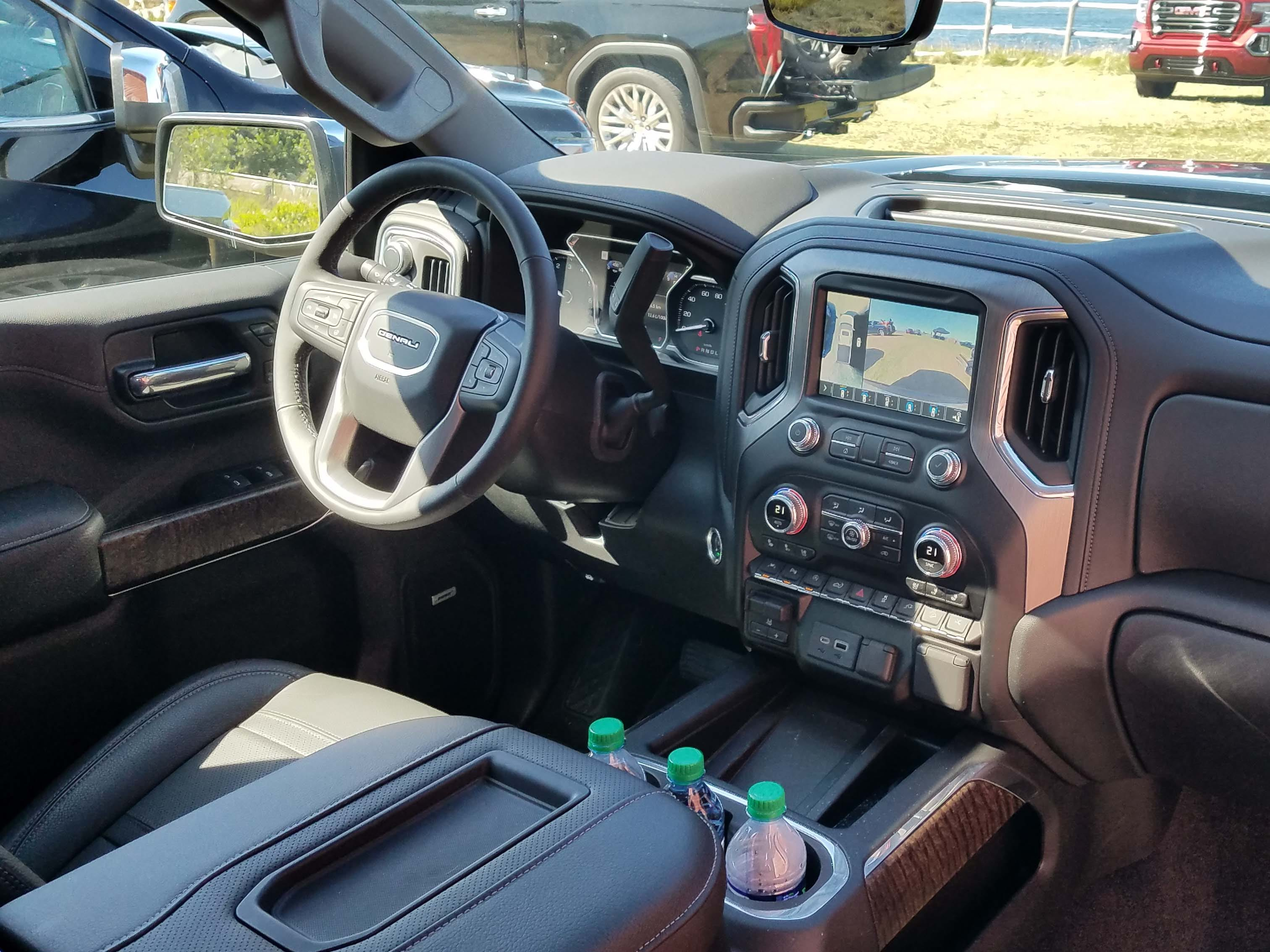 The premium interior on the 2019 GMC Sierra Denali adds wood, leather stitching - and is loaded with tech.