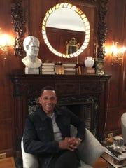 Actor Hill Harper, who bought the house roughly two years ago, sits in the newly redesigned living room.