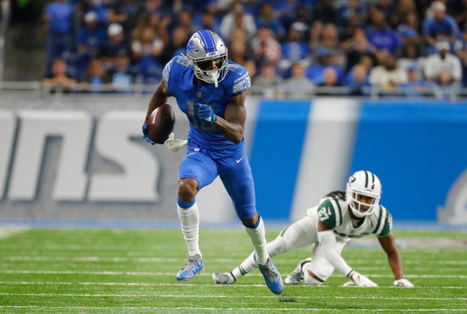 Lions wide receiver Kenny Golladay (19) set career highs Monday night with seven catches for 114 yards.