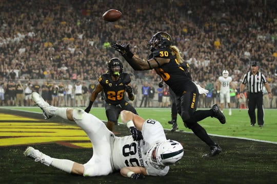 Arizona State defensive back Dasmond Tautalatasi (30) intercepts a pass intended for Michigan State tight end Matt Dotson during the first half Saturday night in Tempe, Ariz.