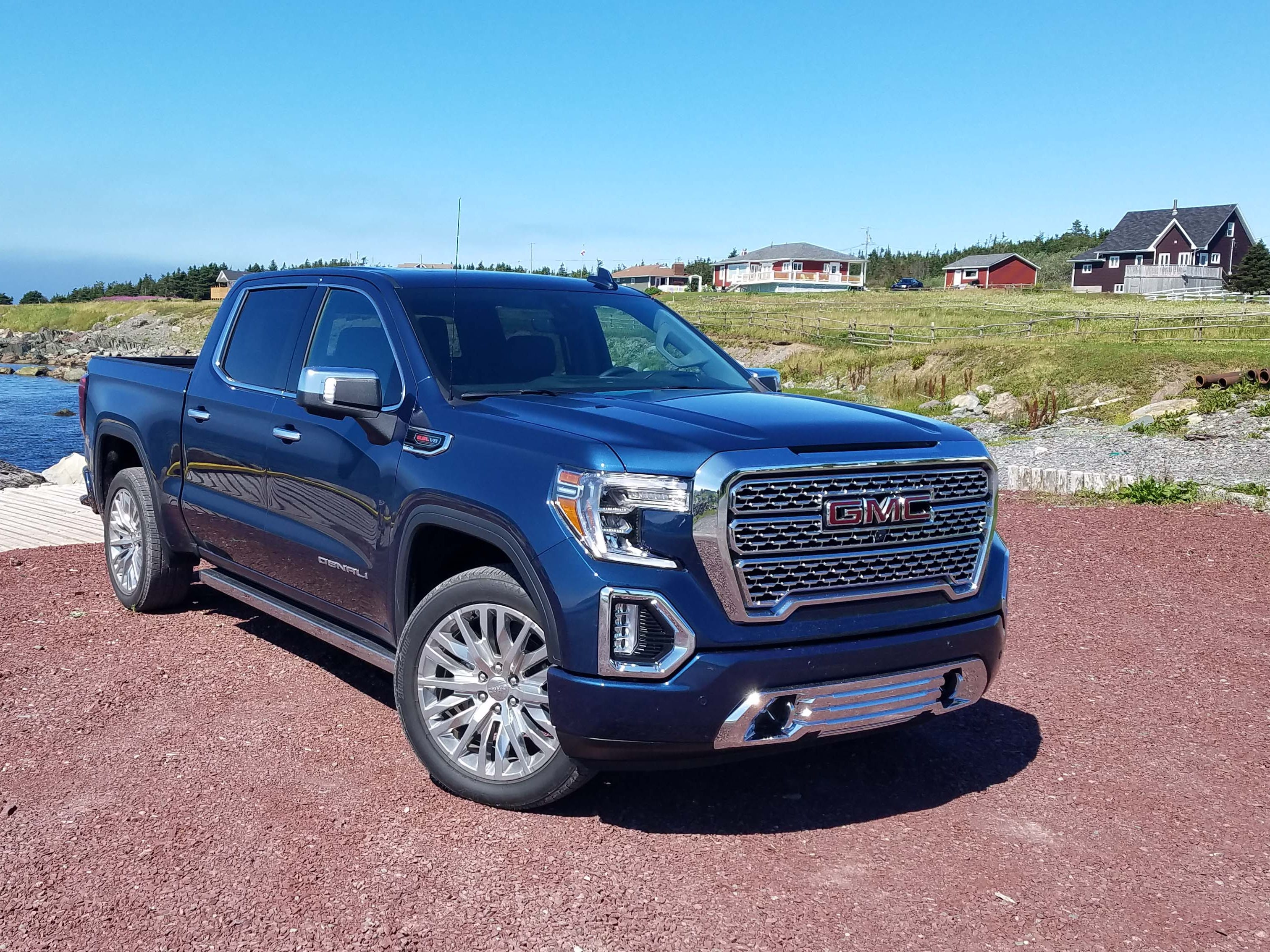 New for 2019, the GMC Sierra Denali starts at $59,495. Its chrome and c-shaped headlghts are classic GMC, but the big truck gets unique features as well over its more working-class Chevy Silverado stablemate.