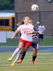 Cora Smith of Waverly and Ellie Mustico of Elmira Notre Dame eye the ball during the Wolverines' 4-0 victory Sept. 12, 2018 at Brewer Memorial Stadium.