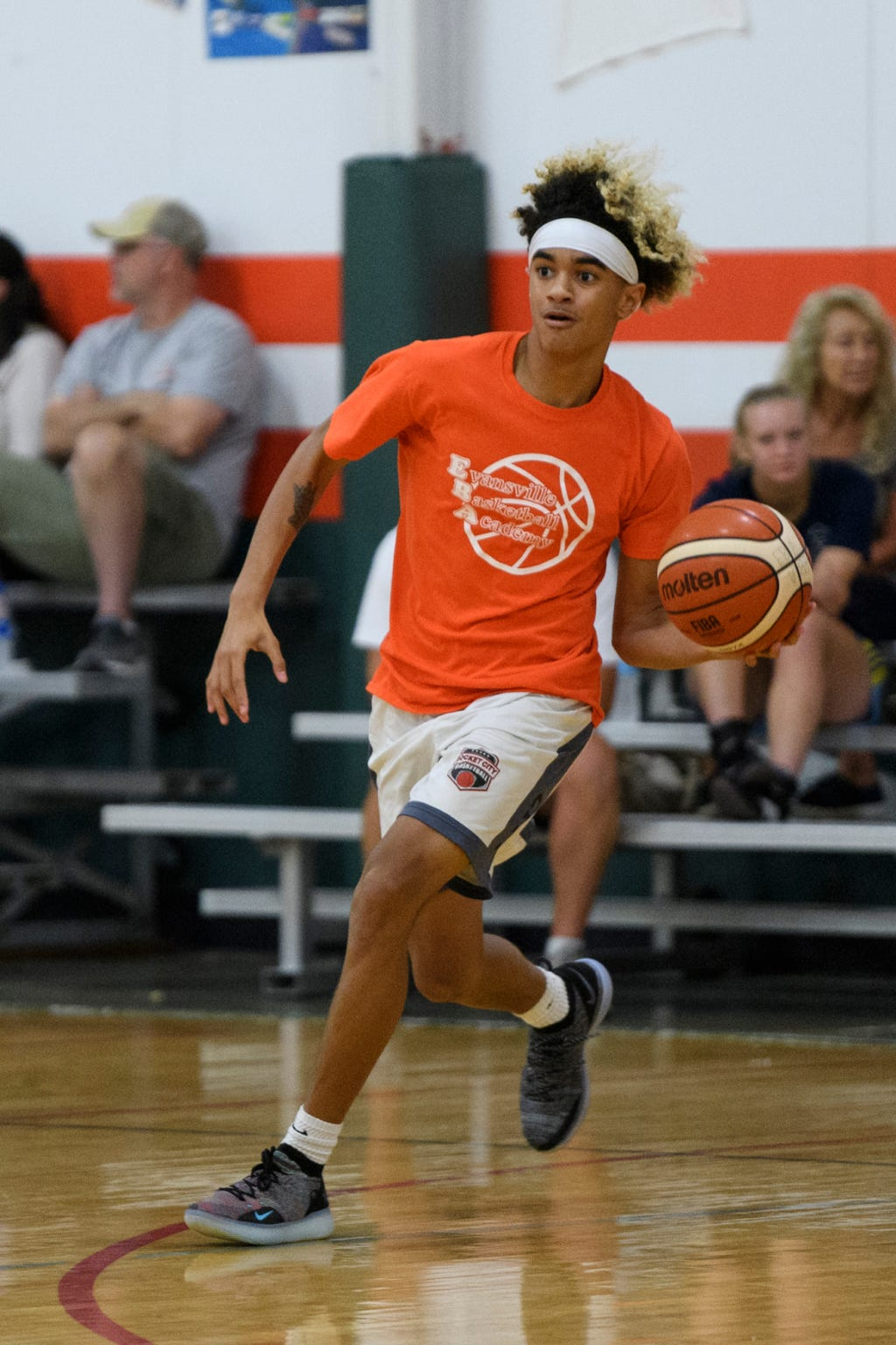 Reitz sophomore Khristian Lander plays in a 4-on-4 basketball game with his team, Young Guns, at the Evansville Basketball Academy in Evansville, Ind., Wednesday, Sept. 12, 2018.