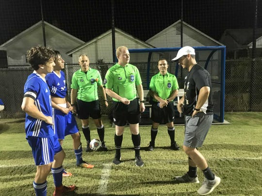 The Memorial and Castle captains (Travis Sides, Marky Lara and Michael Bertram) meet with the referees prior to penalty kicks. The Tigers defeated the Knights in the shootout.