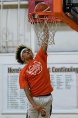 Reitz sophomore Khristian Lander dunks during a 4-on-4 basketball game with his team, Young Guns, at the Evansville Basketball Academy in Evansville, Ind., Wednesday, Sept. 12, 2018.
