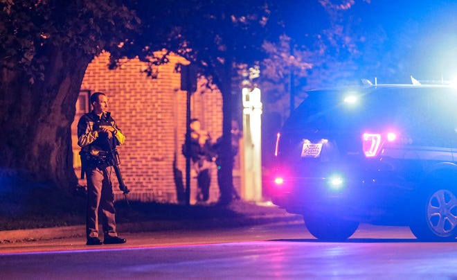 Fond du Lac County and City police officers hold down a perimeter Wednesday, September 12, 2018, around the Forest Avenue Apartments at the corner of Forest Avenue and Military Road in Fond du Lac, Wisconsin, after a report of two people that were shot. Doug Raflik/USA TODAY NETWORK-Wisconsin