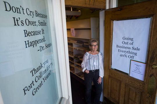Pam Orzell, who has been managing Al's for 21 years and has been an employee for 41 years, poses at the entrance of the store on Thursday, Sept. 13, 2018, at Al's Newsstand in Old Town Fort Collins, Colo.