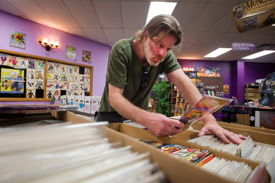 Camak Lyles thumbs through comics looking for back issues of Cable, a Marvel comic character, on Wednesday, Sept. 12, 2018, at Gryphon Games and Comics in Fort Collins, Colo.