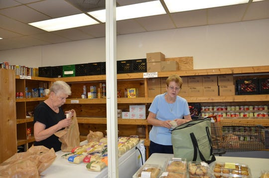 Volunteers collect food and other items at Cape Coral Caring Center.