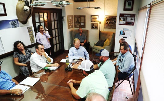 U.S. Sen. Bill Nelson, D-Fla., center,  listens to business owners from Southwest Florida who rely on tourism and water quality to make money. Fishing guides and restaurant owners, among others, were on hand to listen for solutions to the red tide and algae issue.