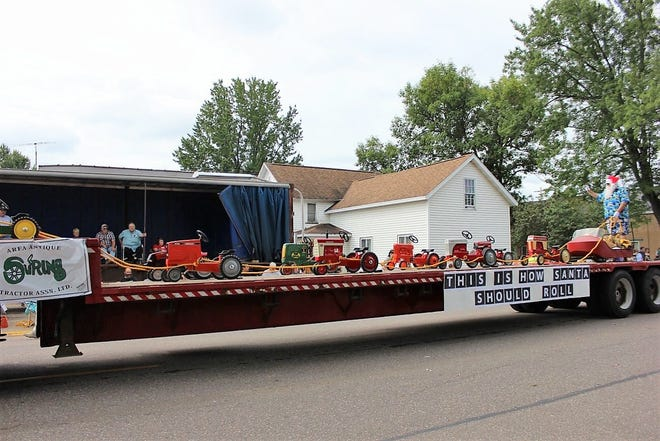 The Suring Antique Tractor Assoication's float was one of eight entries judged best of show in the 88th Suring Labor Day Parade in 2018.  The Suring Labor Day Celebration this year, Sept. 4-7, will be held this year, even though several activites have been canceled because of the pandemic.