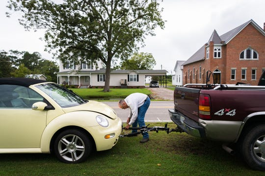Jimmy Williams, 80, prepares to move his vehicles to higher ground at his home in Swan Quarter, N.C as Hurricane Florence makes landfall Sept. 13, 2018.