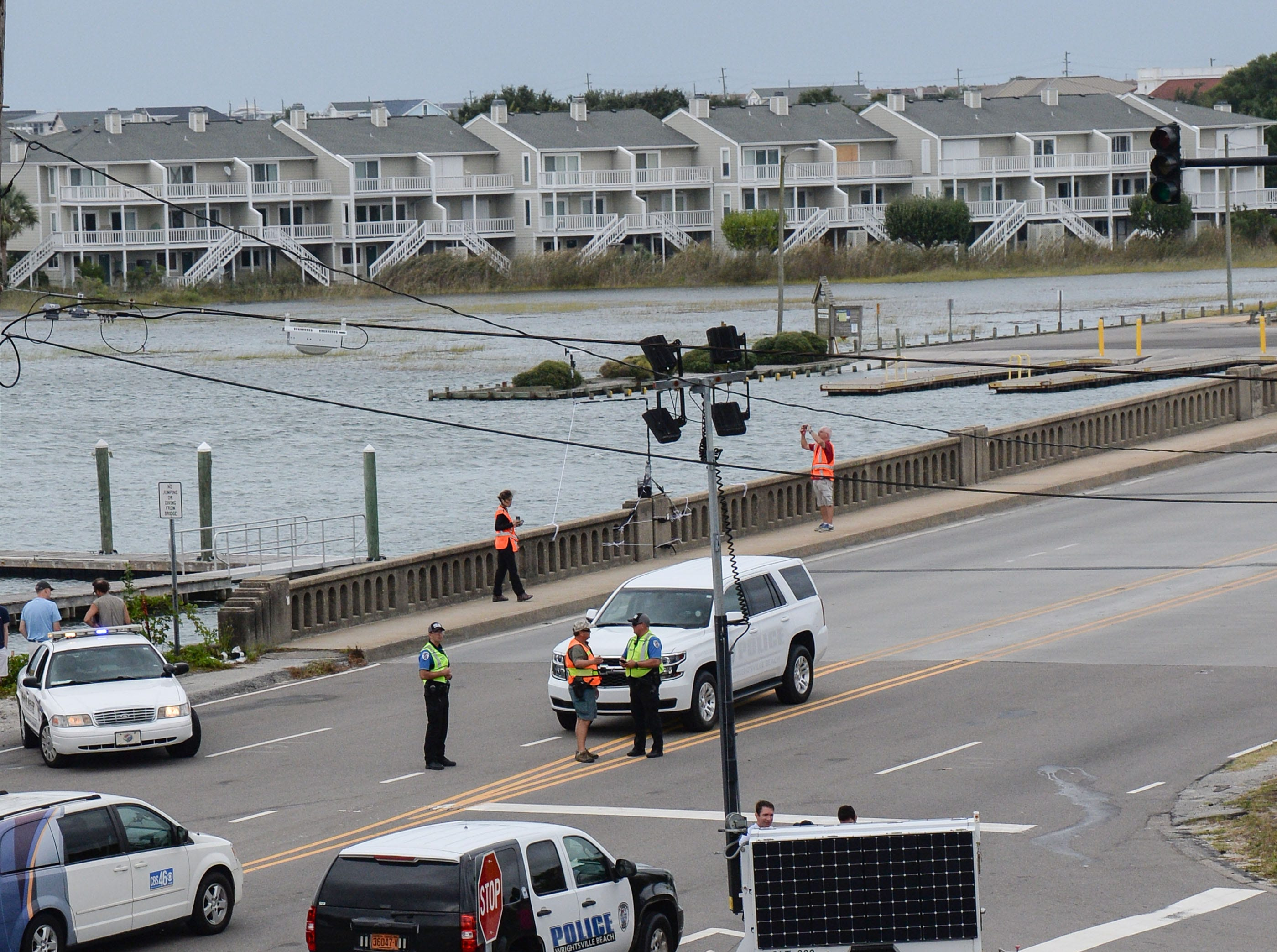 A jogger goes by a roadblock at a bridge to Wrightsville Beach and the Waterway Lodge in Wilmington, North Carolina on Thursday, September 13, 2018. Freed arrived Tuesday. (Ken Ruinard / Greenville News / Gannett USA Today Network / 2018 )