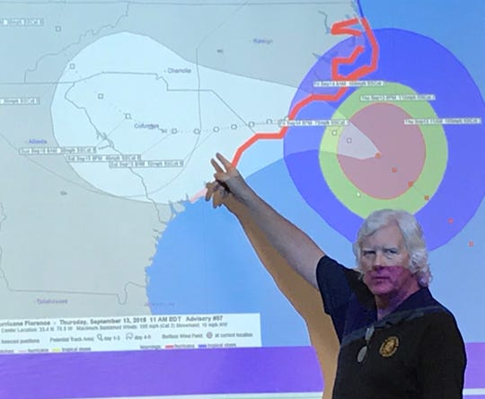 Florence County Emergency Management Director Dusty Owens points to a screen showing the forecast path of Hurricane Florence during a briefing Thursday afternoon.