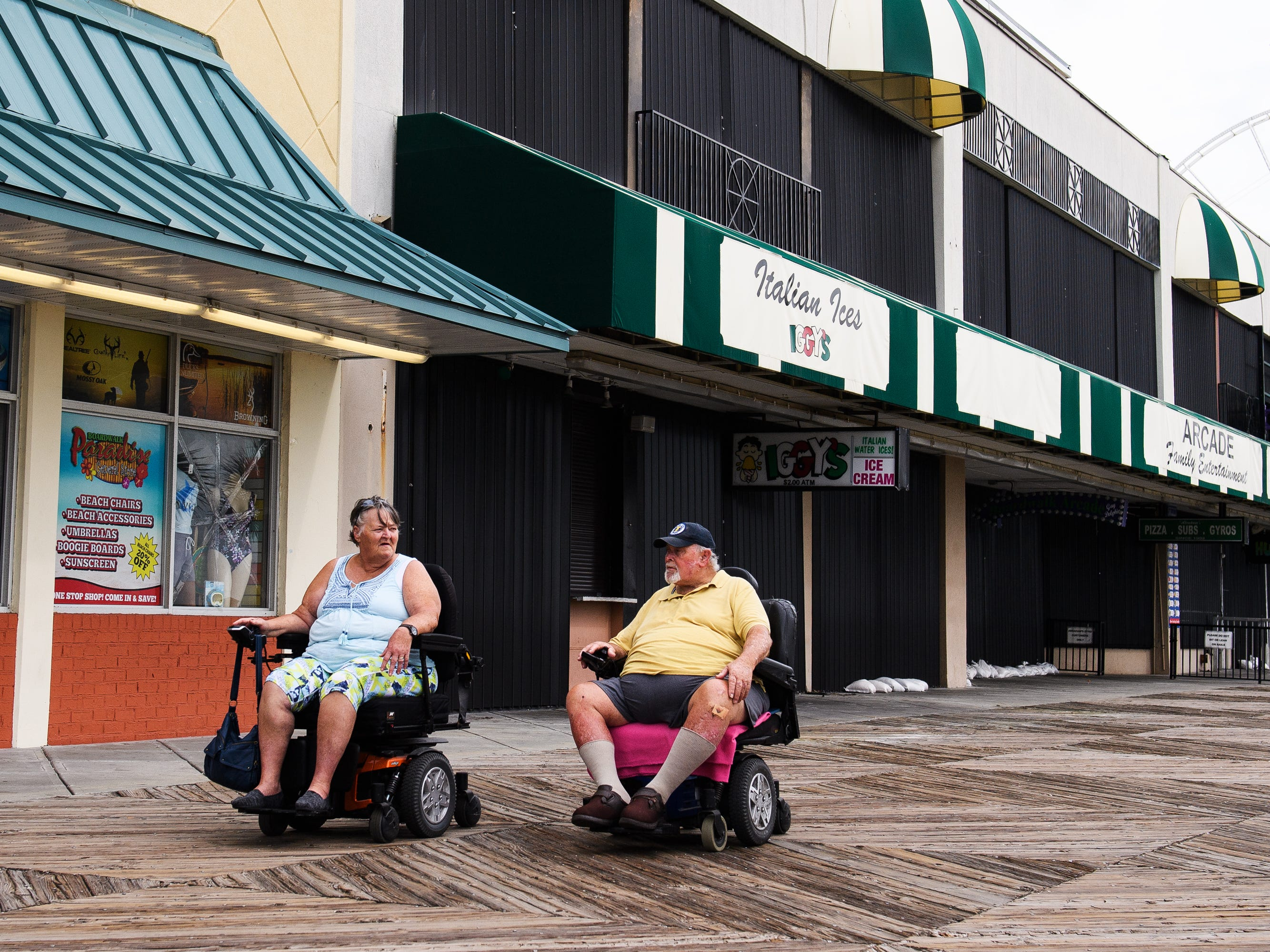 Randy and Carolyn Hardee ride down the Myrtle Beach Boardwalk and Promenade on Thursday, Sept. 13, 2018. Randy said they would have left Myrtle Beach if Hurricane Florence was a category 4, but chose to stay after it had been downgraded.