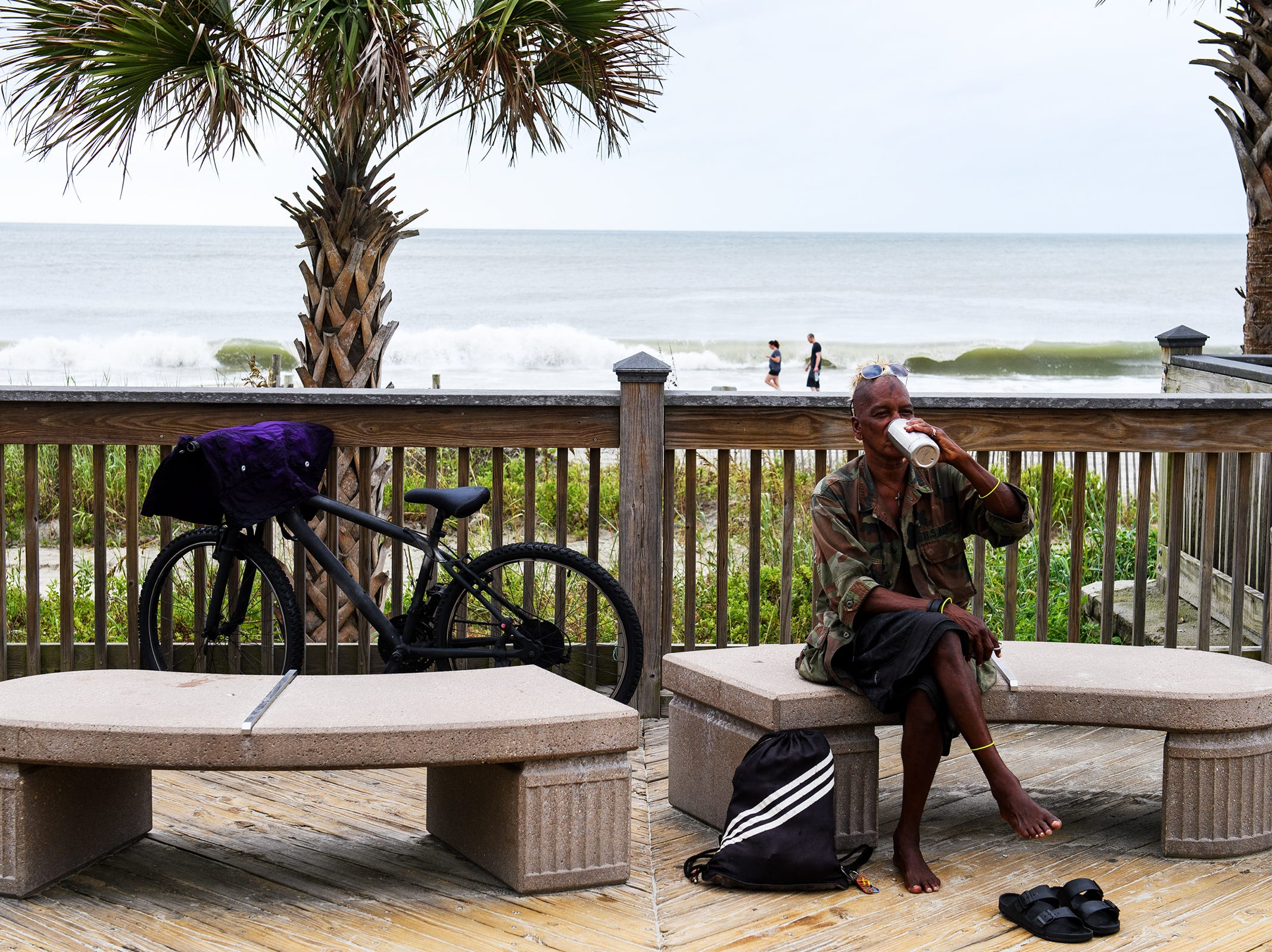 "Shane ""Rooster"" Bacchus, a homeless man living in Myrtle Beach, takes a drink from his water bottle at the Myrtle Beach Boardwalk and Promenade on Thursday, Sept. 13, 2018. Bacchus said he will be sleeping in a truck during Hurricane Florence when it hits this weekend."