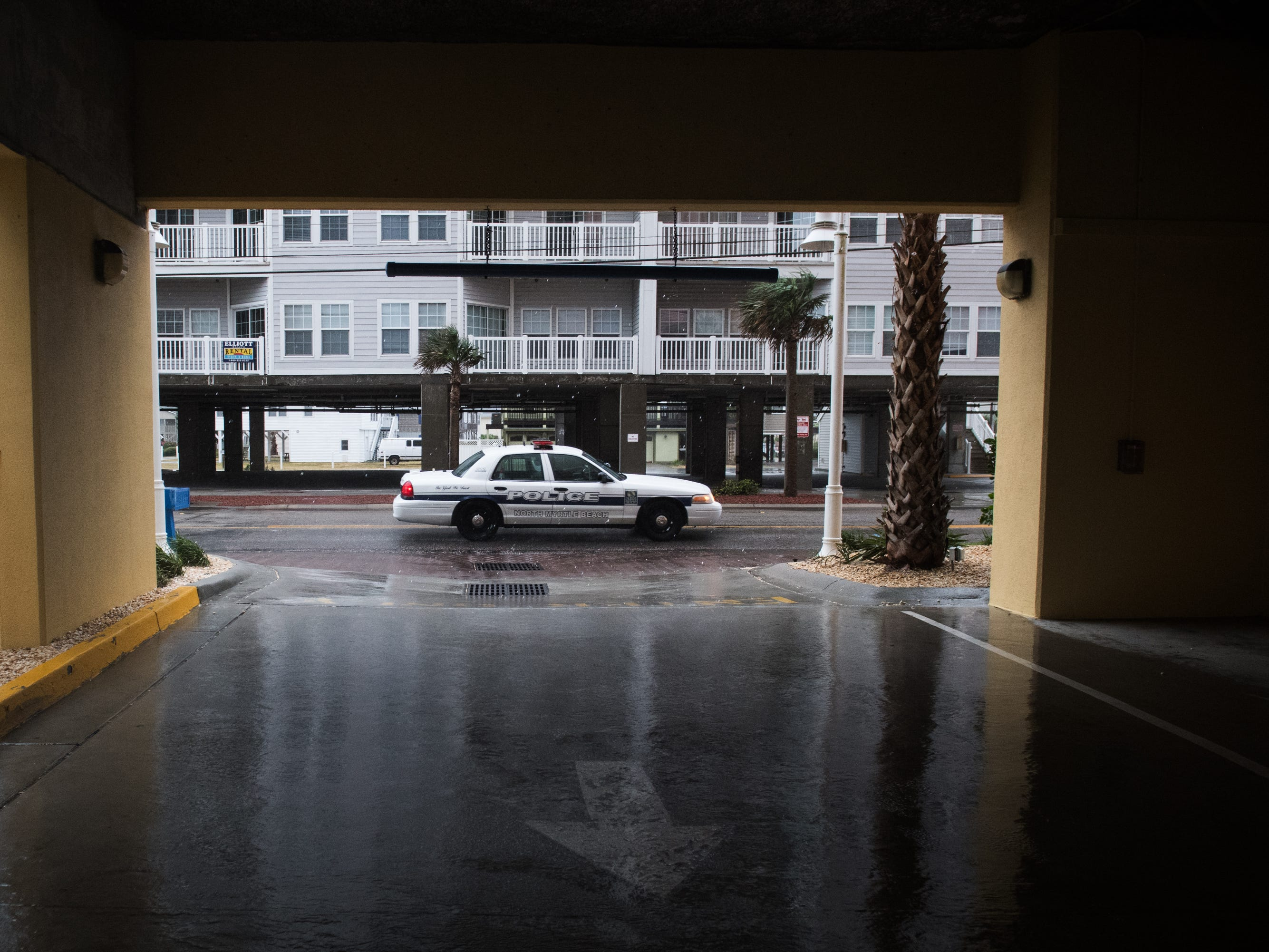 A North Myrtle Beach Public Safety officer drives down North Ocean Boulevard as  the first rain from an outer band of Hurricane Florence hits the Cherry Grove Pier area of North Myrtle Beach on Thursday, Sept. 13, 2018.