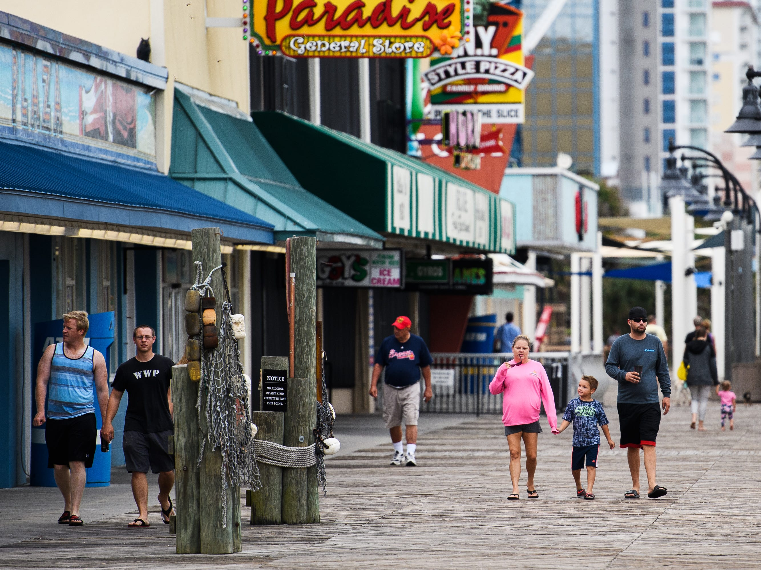 Myrtle Beach residents enjoy the Myrtle Beach Boardwalk and Promenade on Thursday, Sept. 13, 2018 before Hurricane Florence is expected to hit.