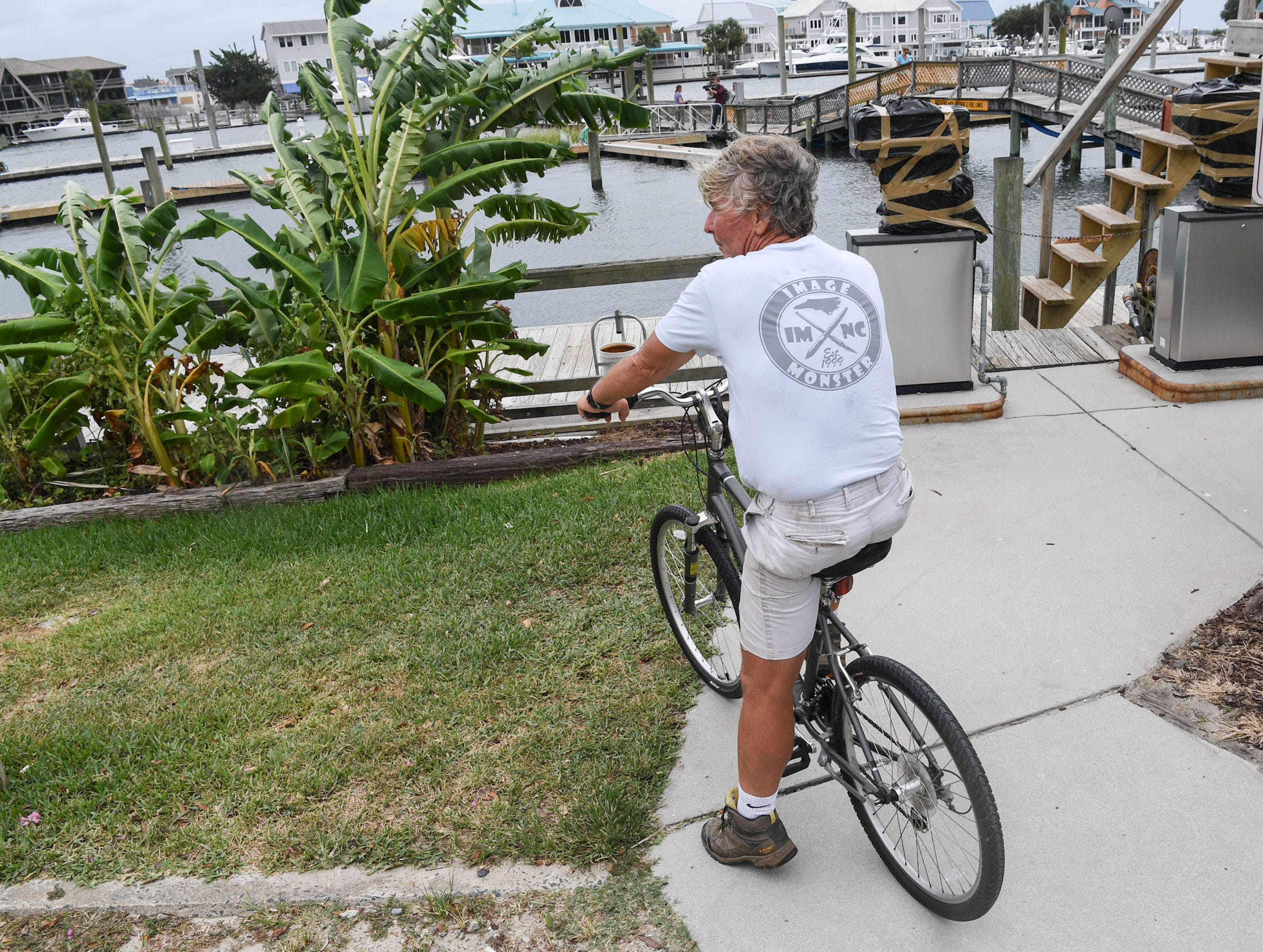 Jimmy Arnoux of Wilmington, N.C. watches a windy gust at Wrightville Beach marina in Wilmington, North Carolina on Thursday, September 13, 2018. (Ken Ruinard / Greenville News / Gannett USA Today Network / 2018 )