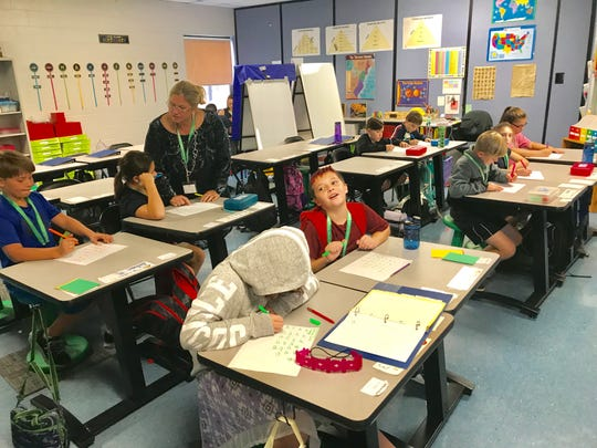 Fourth and fifth graders at Lakes and Bridges Charter School work during a special instruction program.